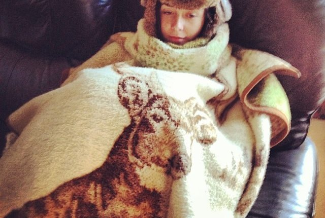 person wrapped in a blanket to prevent cold stress