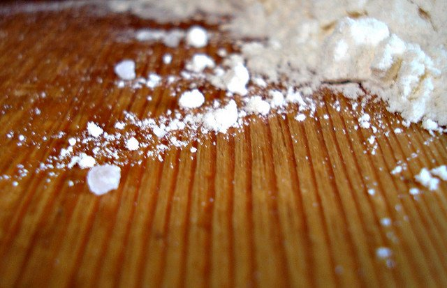 flour dust on a wooden table